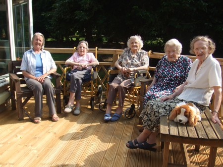 Residents enjoying the sun on the decking