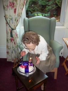 Mrs Brown blowing out the candles